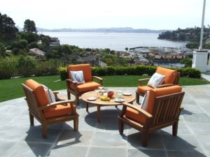 patio with with orange chairs around a table