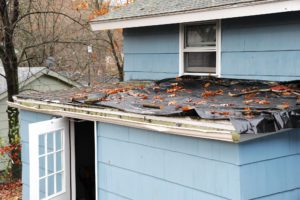 house roof damaged in hurricane storm